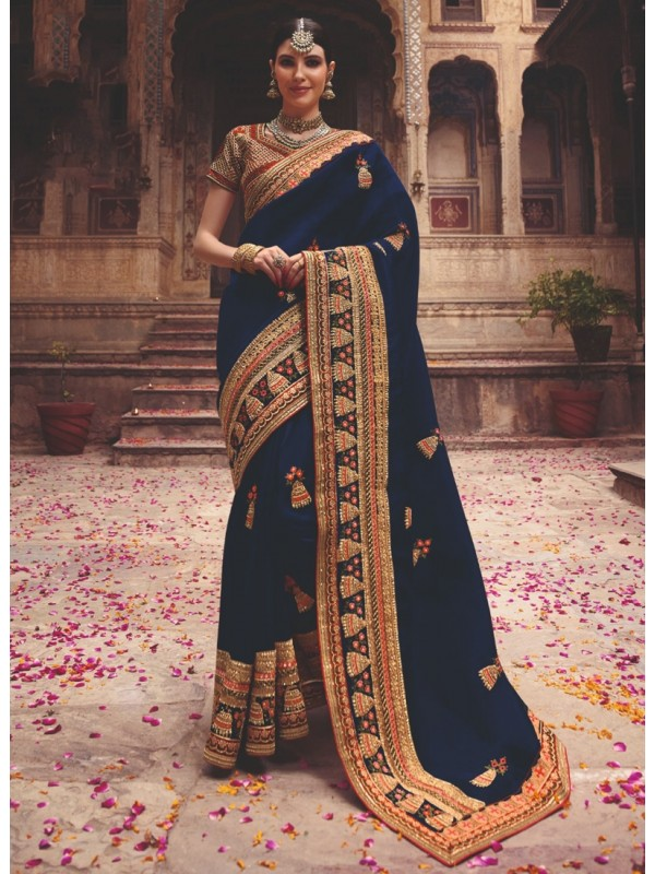 1001366 Heavy Embroidered Red Blouse With Deep Heavy Embroidered Border Navy Blue Silk Saree