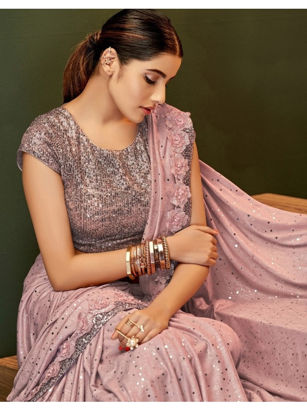 Grasp the aesthetic look in this shimmery and entirely pink saree