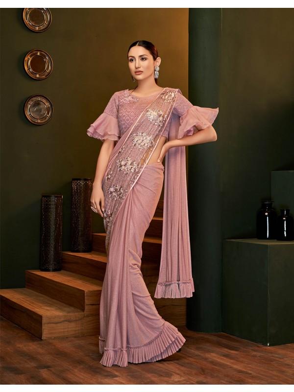 Sleek, cheeky and smooth designer pink saree