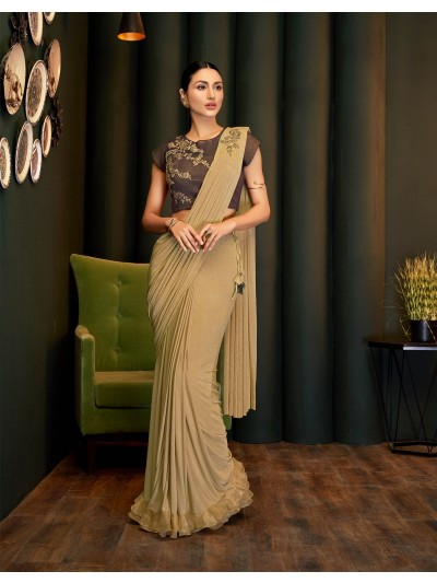 A graceful, complex and elegant pick brown saree